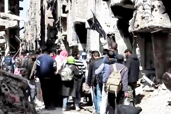 palestinesi uccisi in siria - fuga-da-Yarmouk
